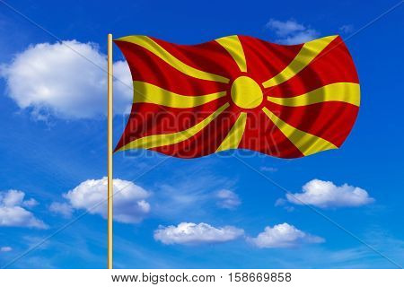 Macedonian national official flag. Patriotic symbol banner element background. Correct colors. Flag of Macedonia on flagpole waving in the wind blue sky background. Fabric texture. 3D rendered illustration