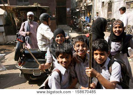 MUMBAI, INDIA - JAN 15, 2010: Unidentified schoolchildren having fun together outdoor after school on 15 January, 2010. Second most populous metropolitan area in India Mumbai has population of 21 million