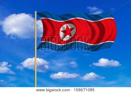 North Korean national official flag. Patriotic DPRK symbol banner element background. Correct colors. Flag of North Korea on flagpole waving in the wind blue sky background. Fabric texture. 3D rendered illustration