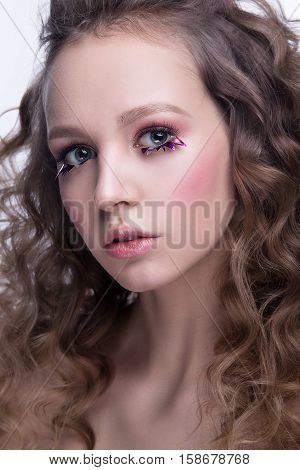 Close-up Portrait Of Beautiful Woman With Bright Makeup And Wavy Hairstyle. Fashion Shiny Highlighte