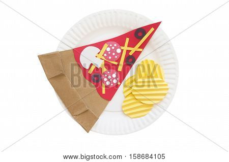 potato chips and pizza from a paper. slice of pizza and potato crisps made of colored paper on a disposable plate. the concept of junk food. isolated on white background, top view