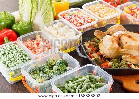 Stir fry vegetables frozen in plastic container roasted chicken and veggies. Healthy freezer food in tray.