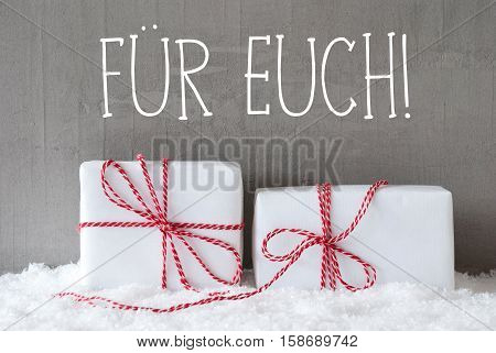 German Text Fuer Euch Means For You. Two White Christmas Gifts Or Presents On Snow. Cement Wall As Background. Modern And Urban Style.