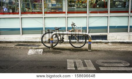 Old Rusty Bicycle Parking Convenient Store Street Concept