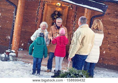 Happy grandparents at xmas eve gathering family