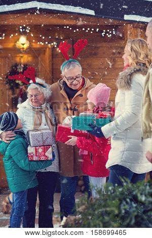Christmas holiday- grandparents gathering children on Christmas eve