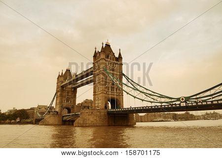 Tower Bridge in London over Thames River as the famous landmark.