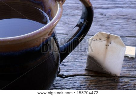 An abstract image of a cup of hot water and a rectangular teabag.