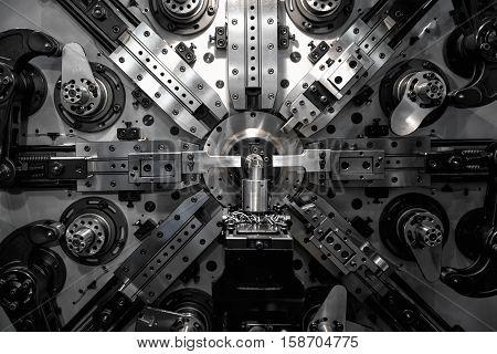 Operator machining automotive part by turning machine Industry machine background