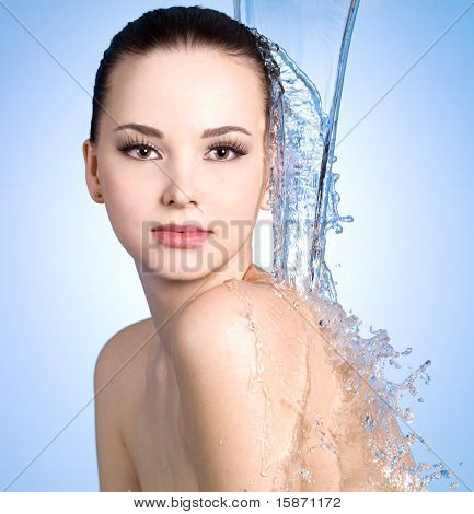 Stream Of Water Falling On The Body Of Woman