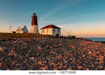 Lighthouse on the Atlantic coast at sunset, Point Judith lighthouse, Rhode Island, USA