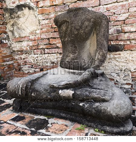Detail of a headless Buddha at Wat Mahathat Temple of the Great Relic a Buddhist temple in Ayutthaya Thailand