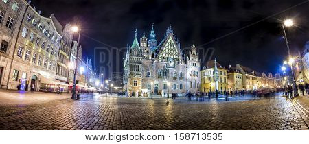 Wroclaw Market Square with Town Hall. Night scene with long exposure motion blurred people
