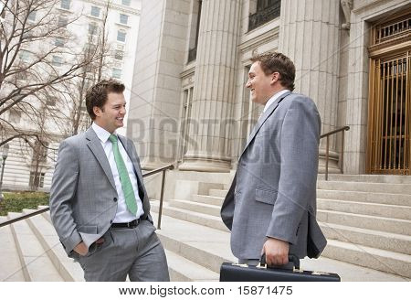 Two Businessmen laughing together