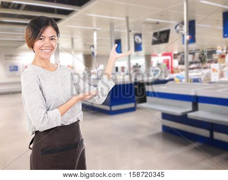 female cashier service at counter supermarket store