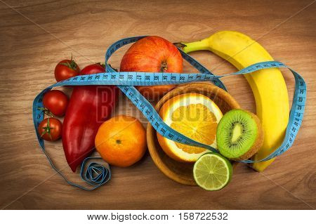Vegetables and fruits on a wooden table. Diet concept. Healthy food. Raw food diet. Weight loss and healthy diet.