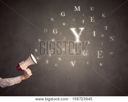 Caucasian arm holding megaphone with letter cloud