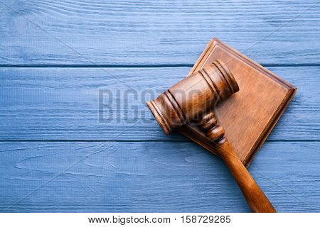 Judge's gavel and sound block on wooden background, top view