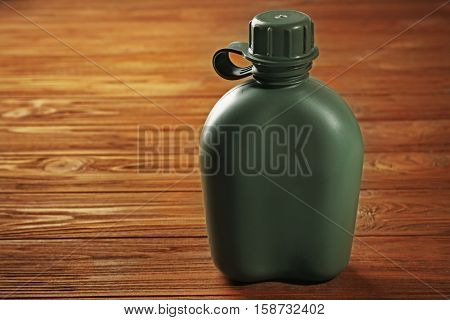 Close up view of military canteen on wooden background