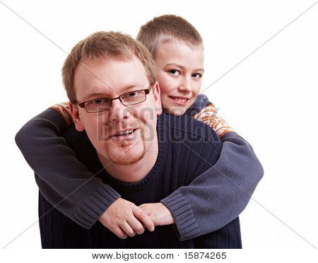 Father Giving His Son A Piggyback Ride