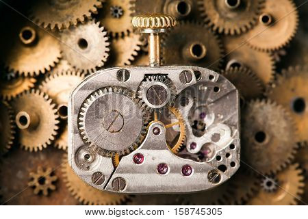 Antique mechanical hand watch macro view. rusty grunge textured metal gears background. Shallow depth of field