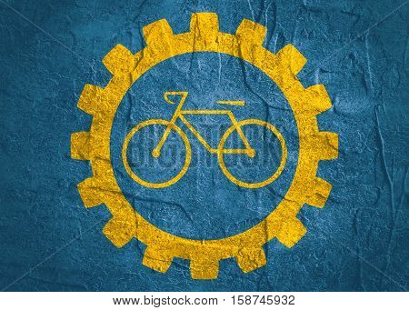 bicycle icon in gear. Minimalistic sign on concrete textured background. Trendy Flat style for graphic design