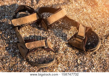 Sandals covered in sand. Crushed seashells and sand. Get lost on the island. Escape to the sea.