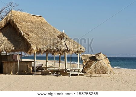 Seaview on bamboo hut on beach  with turquoise waters behind it