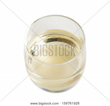 Glass of white wine closeup. Isolated on a white background.