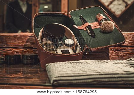 Gentleman's accessories on a luxury wooden board.