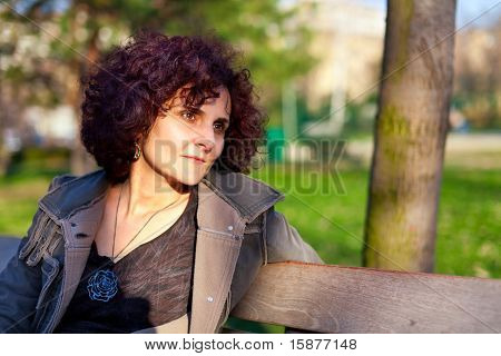 Attractive Curly Redhead Lady In Park