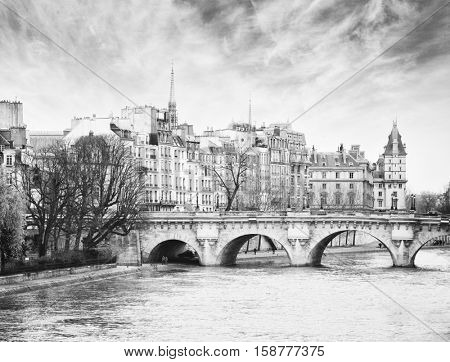 Pont Neuf in central Paris, France.  The Pont Neuf  is the oldest standing bridge across the river Seine in Paris.  Black and white.  Noise added