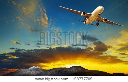 plane flying against beautiful sun rising sky for traveling theme