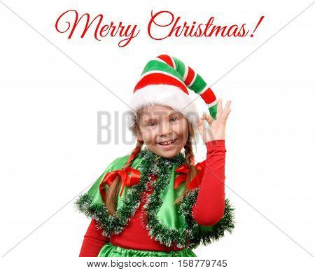 Girl - Santa's elf showing sign OK. Isolated on the white background