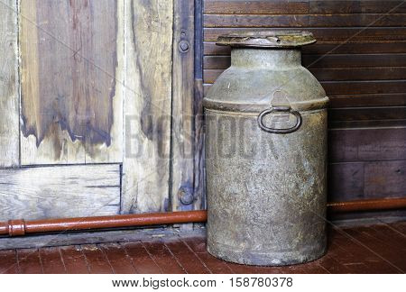 Portland Maine USA - August 10 2009: Old milk can displayed at Maine Narrow Gauge Railroad Co & Museum