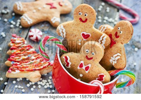 Gingerbread man cookies in red cup Christmas holiday baking background festive treats and sweet gift for kids
