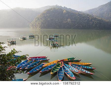 Colour boats on Phewa lake. Pokhara, Nepal