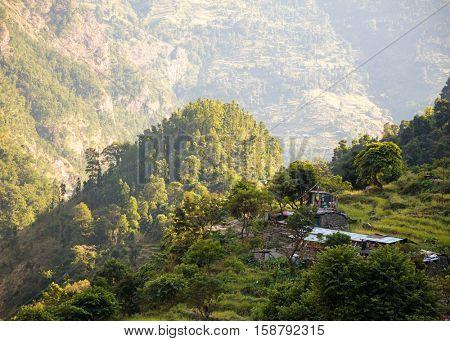 Traditional small nepali village in the mountains in sunset lights. Manaslu circuit trek, Nepal