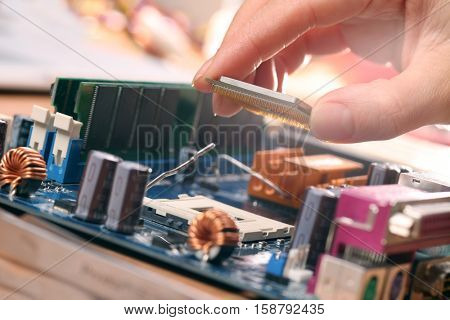 Plug in CPU microprocessor to motherboard socket. Technological background