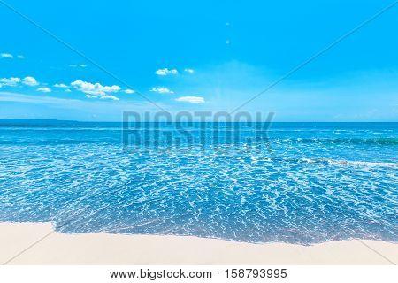 Beach and beautiful tropical sea under clear blue sky