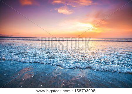 Sunset over sea on Bali, Seminyak, Double six beach