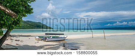 Fisherman Boat on Kri Island, Raja Ampat, Indonesia, West Papua. Banner
