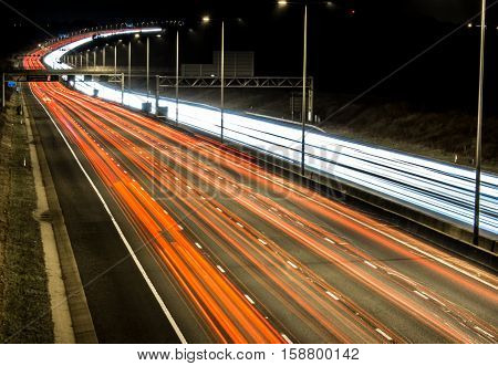British M1 motorway at night with white and red lights trails