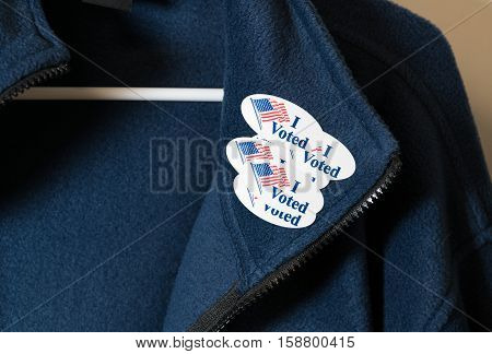 Many I Voted Stickers On Blue Jacket Hung On Hanger