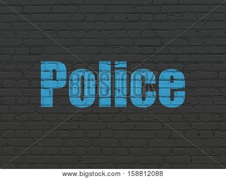 Law concept: Painted blue text Police on Black Brick wall background