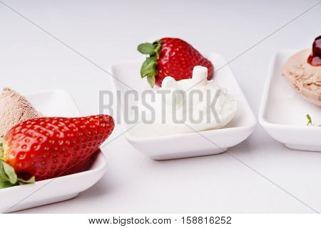Ice cream sundaes in a white dishes