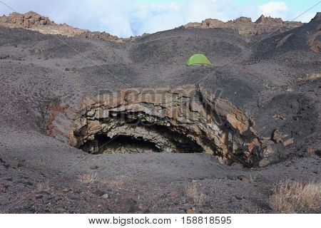 Grotta del Gelo (Cave Ice) and green tent in Etna Park, Sicily