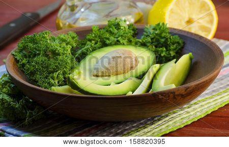 slices of fresh avocado on a cutting board