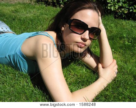 Model Laying In The Grass