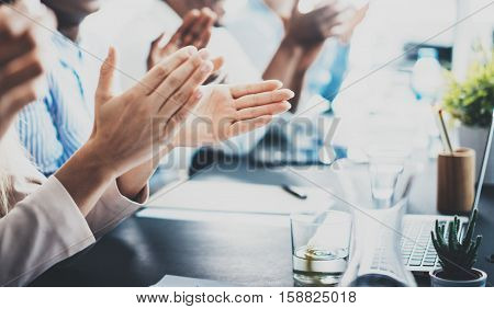 Closeup photo of partners clapping hands after business seminar. Professional education, work meeting, presentation or coaching concept.Horizontal, blurred background